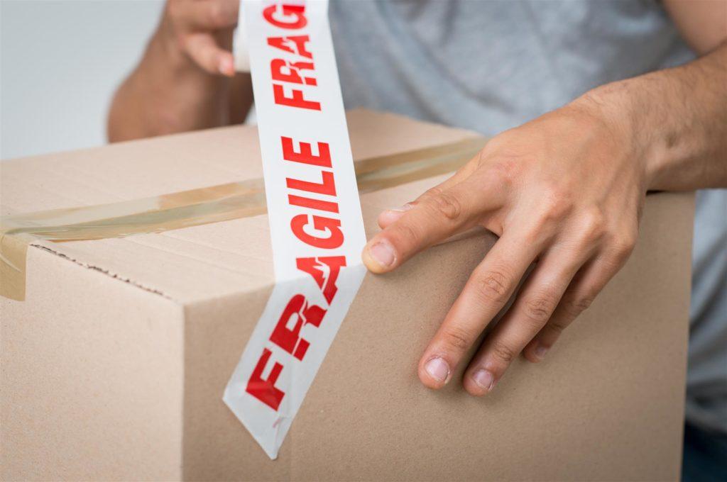 red-fragile-label-tape