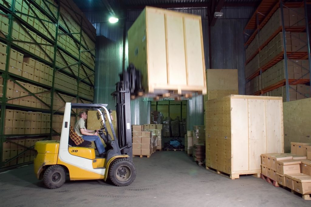 Forklift lifting a box