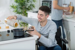 disabled young man in wheelchair in the kitchen