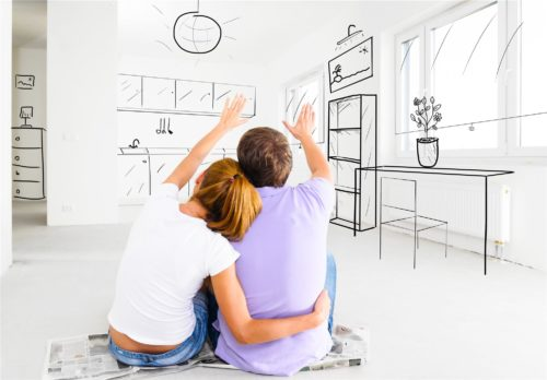 young couple looking at floor plans