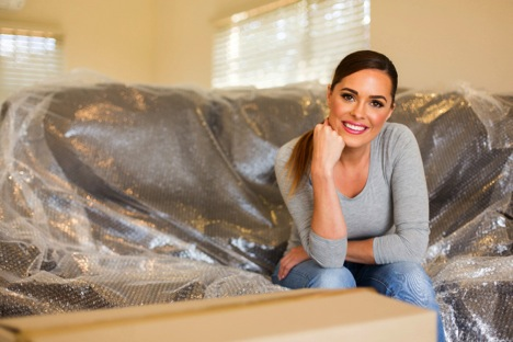 Girl sitting on Bubble wrapped sofa