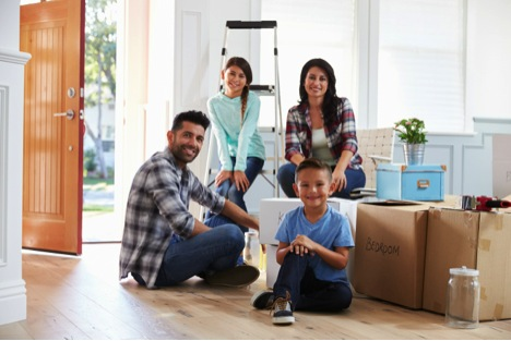family moving with boxes