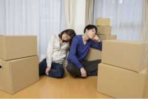 Tired Couple with packed boxes