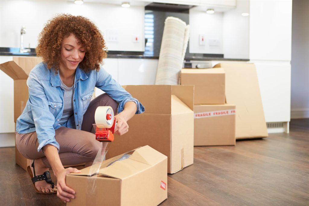 woman is packing household things
