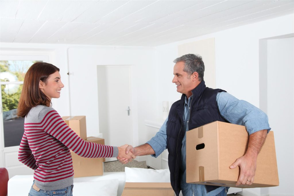 woman is shaking hand to residential moving company attendant