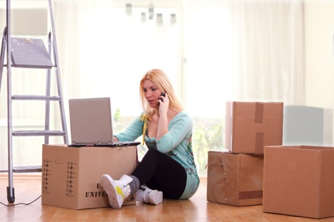 woman with packed boxes