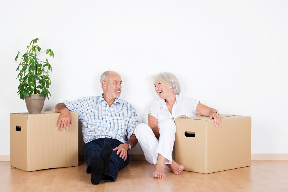 laughing elderly couple in the move